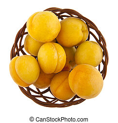 apricots in a basket isolated on white background closeup