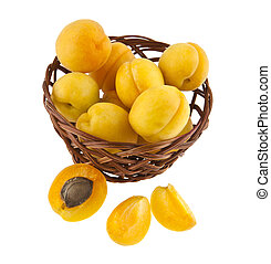 apricots in a basket isolated on white background