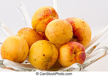 Apricots in a glass vase