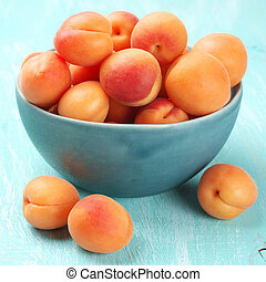 Apricots in blue bowl