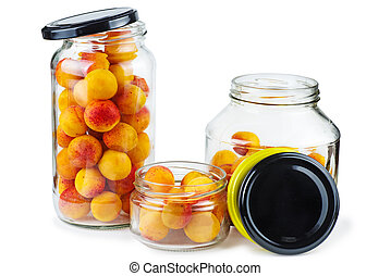 Apricots prepared for canning in glass jars isolated on white background