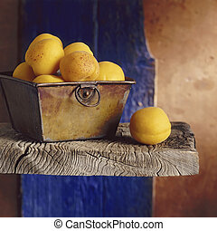 Apricots still life - Apricots on a shelf with blue and...