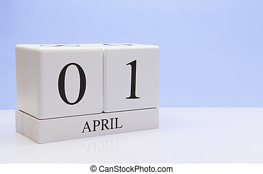 April 01st. Day 01 of month, daily calendar on white table with reflection, with light blue background. Spring time, empty space for text