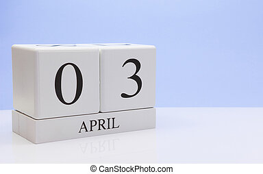 April 03st. Day 03 of month, daily calendar on white table with reflection, with light blue background. Spring time, empty space for text