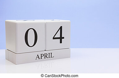 April 04st. Day 04 of month, daily calendar on white table with reflection, with light blue background. Spring time, empty space for text