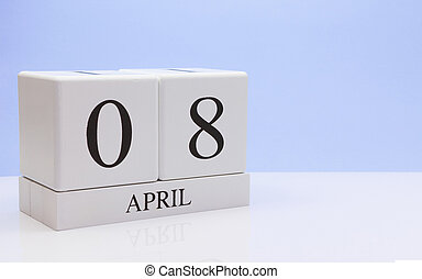 April 08st. Day 08 of month, daily calendar on white table with reflection, with light blue background. Spring time, empty space for text