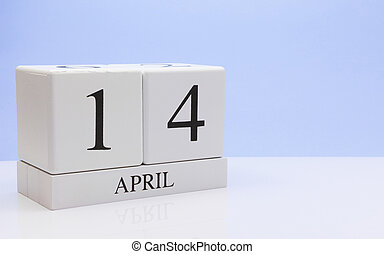 April 14t. Day 14 of month, daily calendar on white table with reflection, with light blue background. Spring time, empty space for text