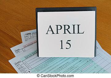 April 15 on calendar, 1040 tax forms - April 15 on desk ...