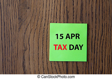 April 15 tax daywritten on colorful sticky notes . New year ...