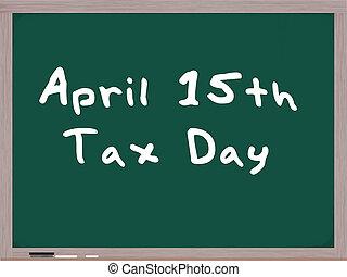 April 15th Tax Day written on blackboard
