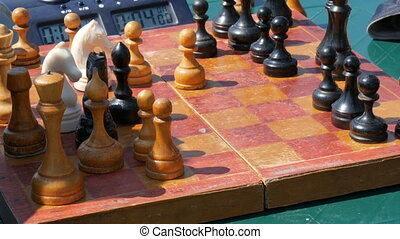 April 21 - Kamenskoye, Ukraine: Children play chess in...