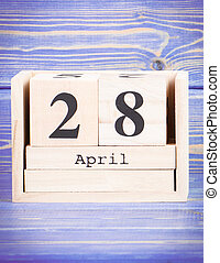 April 28th. Date of 28 April on wooden cube calendar
