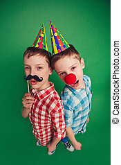 Cute twin brothers celebrating fool?s day