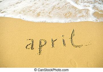 April - written in sand on beach texture