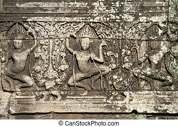Apsaras carved on the wall of Angkor Wat