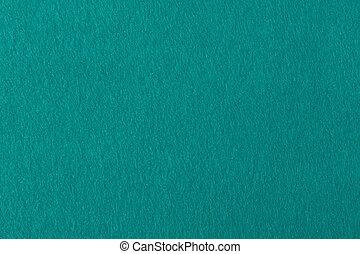 Aqua color felt background for design.