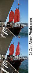Aqua Luna II chineese junk touring boat at Pier 1 Kowloon side of Victoria harbor, Hong Kong