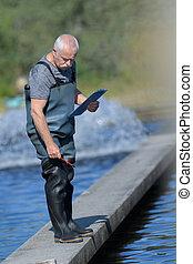aquaculture fisherman inspecting the area