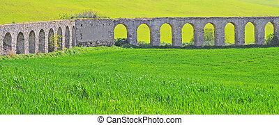 aquaduct in lazio, italy - antique roman aquaduct created by...
