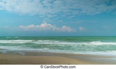 Aquamarine sea tide and clouds time lapse video clip