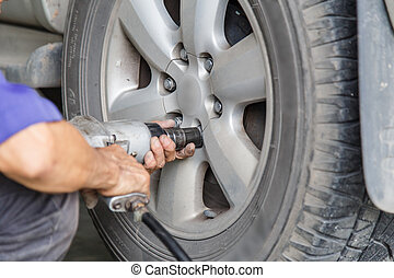 ar wheel changed by auto mechanic