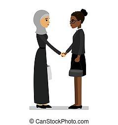 Arab and african american women shake hands
