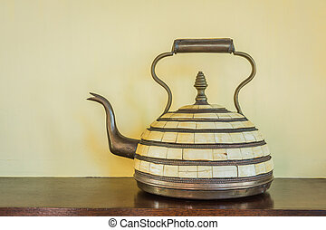 Arab antique teapot on a wood table