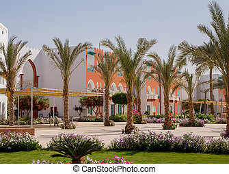 Arab buildings with palm trees in the hotel