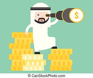 Arab business man stands on stack of gold coin using ...