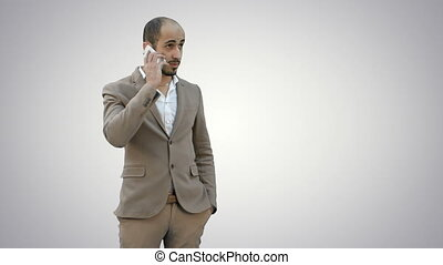 Arab business man talking on the mobile phone on white background.