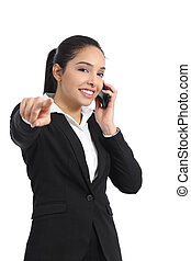 Arab business woman on the phone pointing at camera