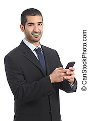 Arab businessman using a smartphone and looking at camera