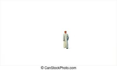 Arab businessman walking walking against white