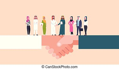 Arab Businessmen Shaking Hands With Team Of Muslim Businesspeople, Business Agreement And Partnership Concept