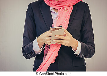 Arab businesswoman messaging on a mobile phone