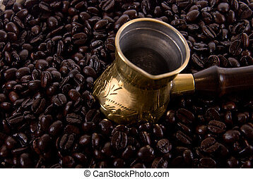 Arab coffee maker in the coffee beans