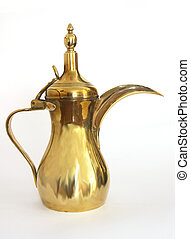 Traditional Arab brass coffee pot or dallah, a symbol of welcome.
