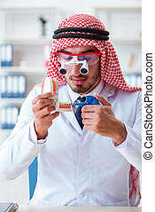 Arab dentist working on new teeth implant