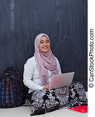 arab female student working on laptop