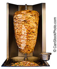Grilled skewered chicken, a traditional meat served inside a shawarma sandwich in the Arab countries in Middle East, cooking in machine isolated on pure white background