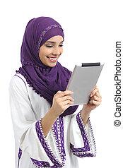 Arab happy woman reading a tablet reader