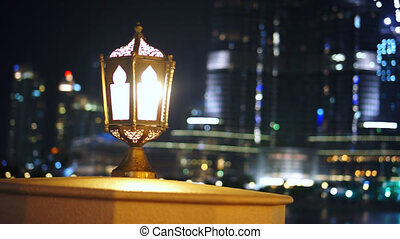 Arab lamp next to the Burj Khalifa. - Arab lamp next to the...