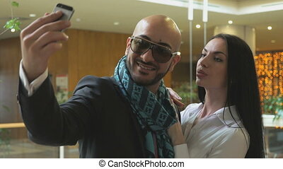 Arab man and a girl making a selfie with smiles
