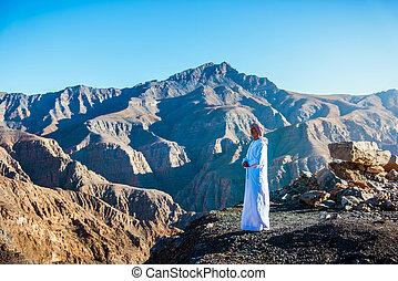 Arab man at the Jebel Jais desert mountain in Ras al Khaimah UAE