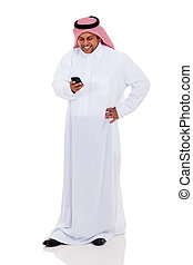 arab man reading email on smart phone - cheerful arab man...