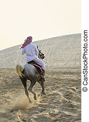 Arab Man Riding A Horse In The Desert - An anonymous Arab...