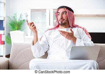 Arab man working at home on his work