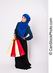 Arab or Muslim woman with shopping bags