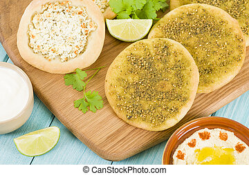 Arab Pizza - Zaatar & Cheese Manakish - Flatbreads topped...