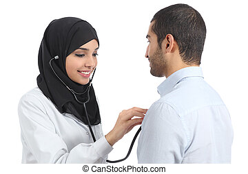 Arab saudi doctor woman examining patient